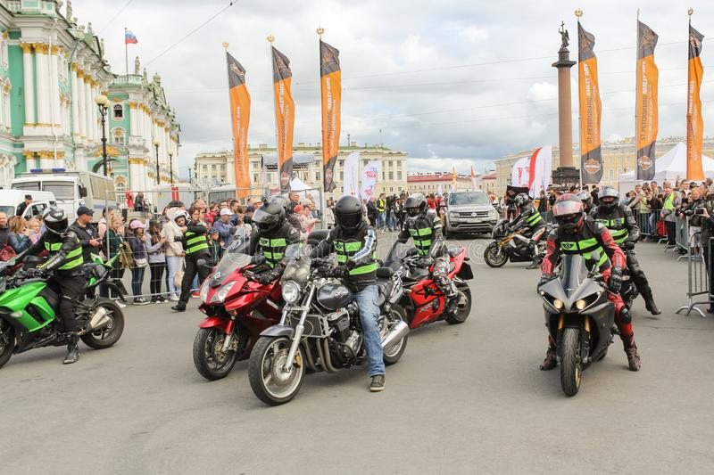 A group of motorcyclists ensure safety in the launch area royalty free stock photos