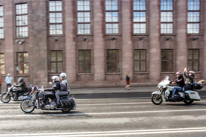 A group of motorcyclists in motion stock photography