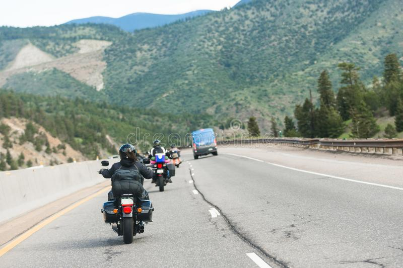 Group of motorcyclists ride through mountain pass royalty free stock image