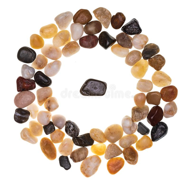 Group of multi-colored stones multicolored surrounding an individual. Multidisciplinary and multiracial group concept. Isolated on white background Collection stock images