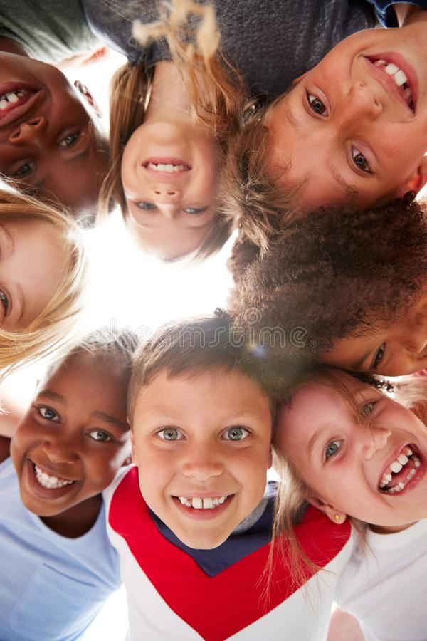 Group Of Multi-Cultural Children With Friends Looking Down Into Camera royalty free stock photo
