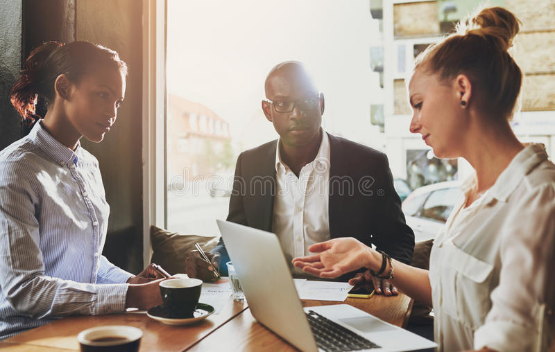 Group of multi ethnic business people at a meeting stock photos