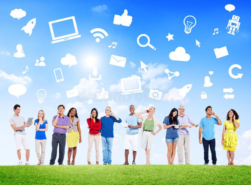Group Of Multi-Ethnic People Social Networking Outdoors And Related Symbols Above.  royalty free stock photos
