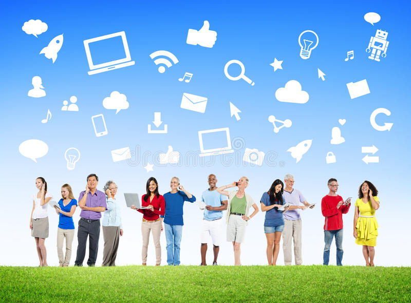 Group Of Multi-Ethnic People Social Networking. Outdoors And Related Symbols Above stock images