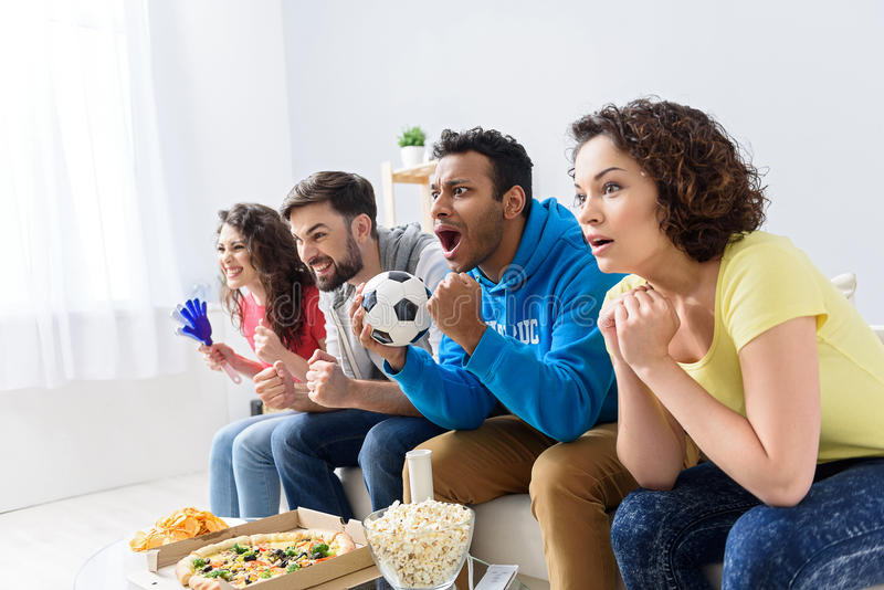 Group of multi national football fans cheerin stock image