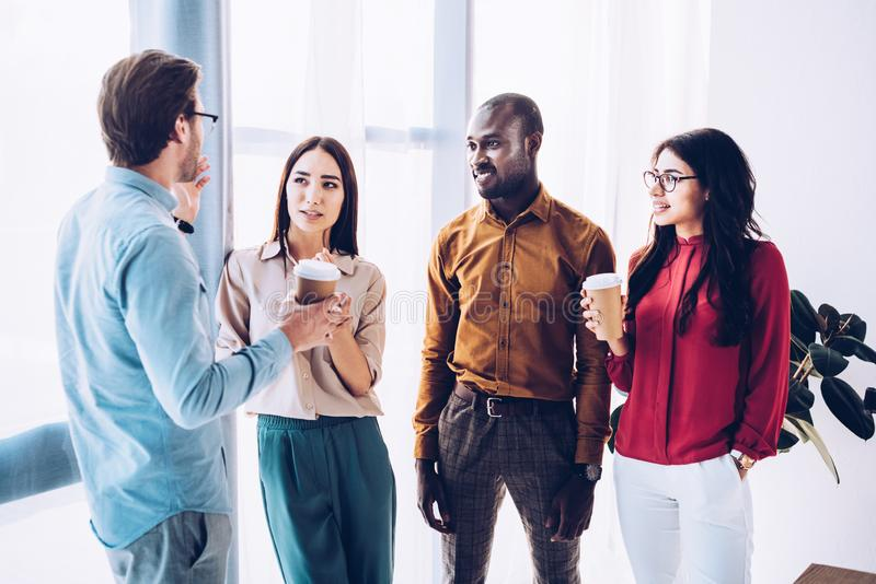 group of multicultural business people having conversation during coffee break stock photo