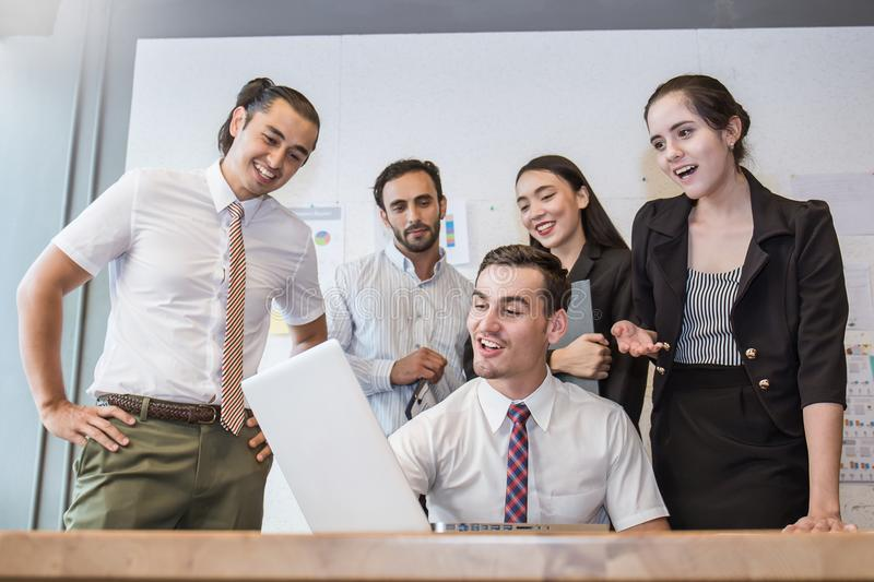 Group of multicultural employees talking and having fun in the business meeting. Elegant young business partners men and women listening to colleague at stock image