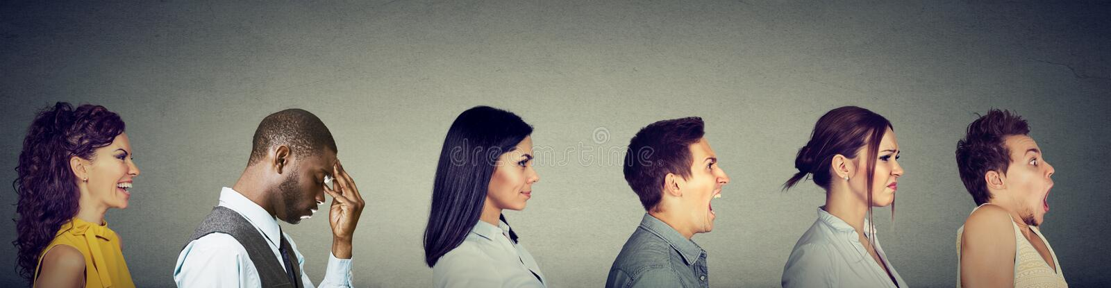 Group of multicultural young people men and women expressing different emotions stock photos