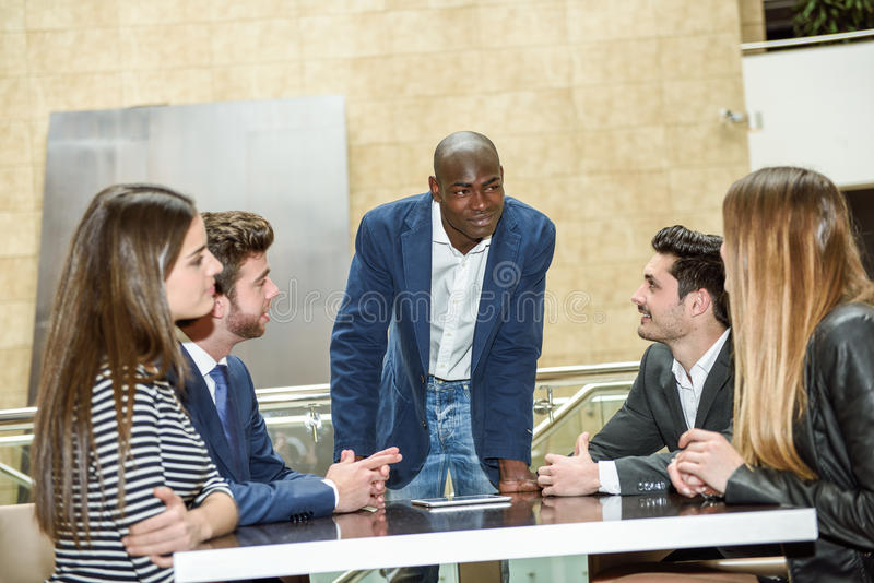 Group of multiethnic busy people working in an office royalty free stock photos