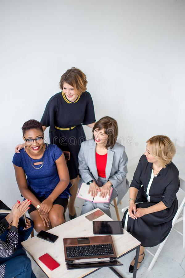Group of Multiethnic Female team working in Office. Group of successful mixed race female entrepreneurs meet together to discuss future plans, make analysis royalty free stock photography