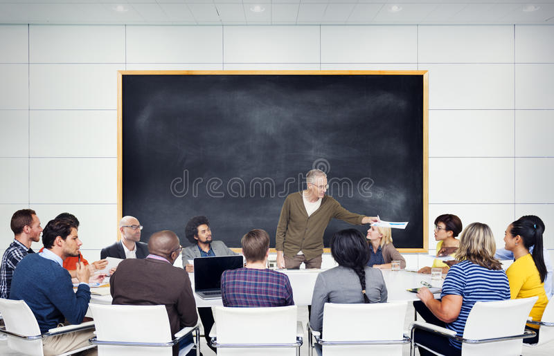 Group of Multiethnic Students Listening to the Speaker stock photo
