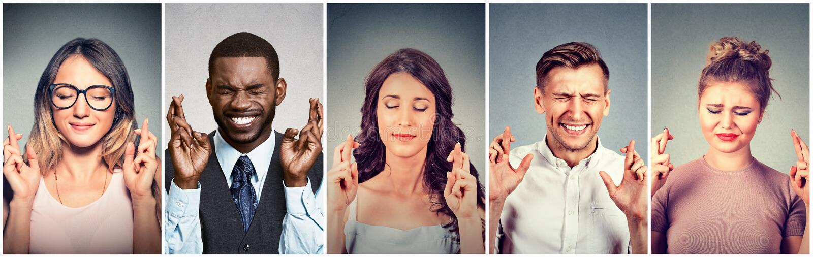 Group of multiethnic young people hopeful crossing their fingers hoping stock image