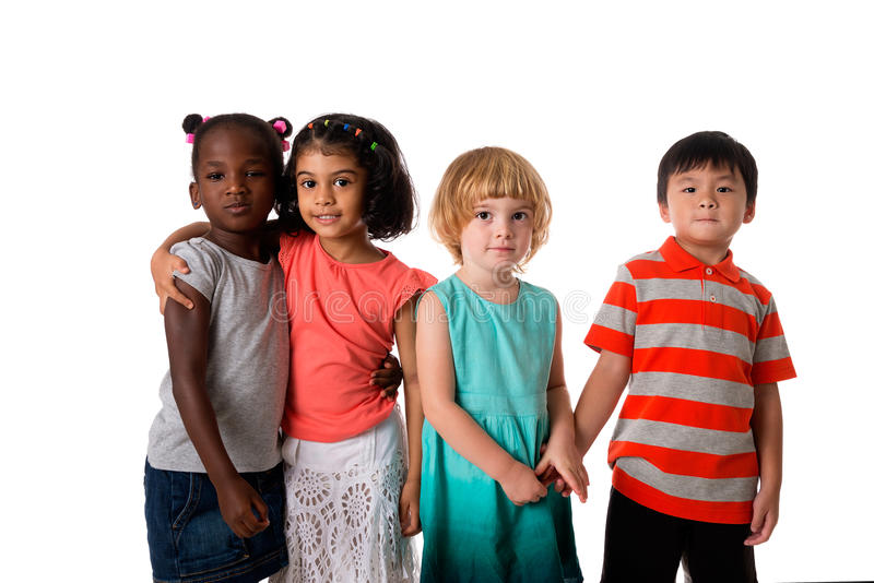 Group of multiracial kids portrait in studio.Isolated stock images