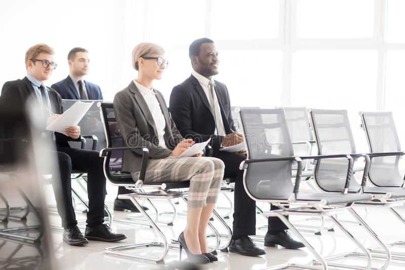 Diverse colleagues on meeting in hall royalty free stock photography