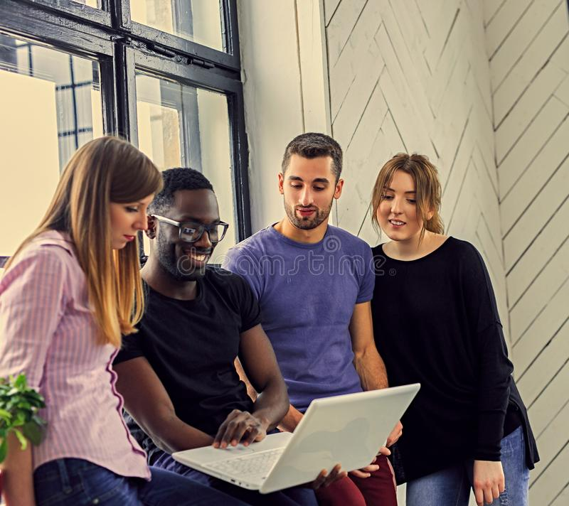 Multiracial students in a room stock photography