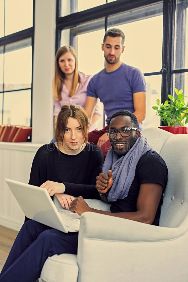 Multiracial students in a room royalty free stock photography