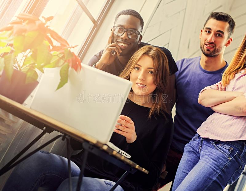 Multiracial students in a room royalty free stock photo