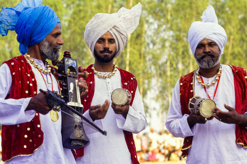 Group of Sikh Musicians in the Punjab, India. Three male sikh musicians, dressed in traditional clothes, playing at a festival in the Punjab, India royalty free stock photo