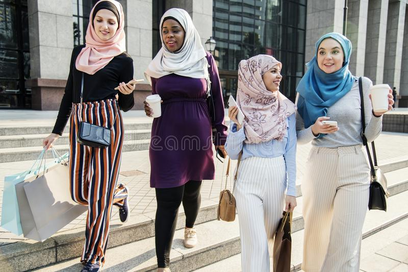 Group of muslim friends hanging out royalty free stock photos