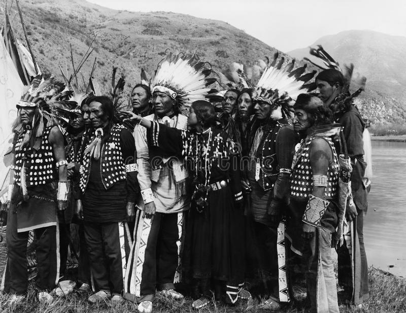 Group of Native Americans in traditional garb stock photography