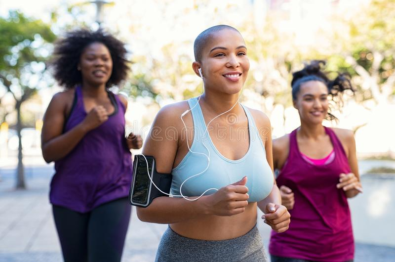 Group of natural curvy women jogging royalty free stock image