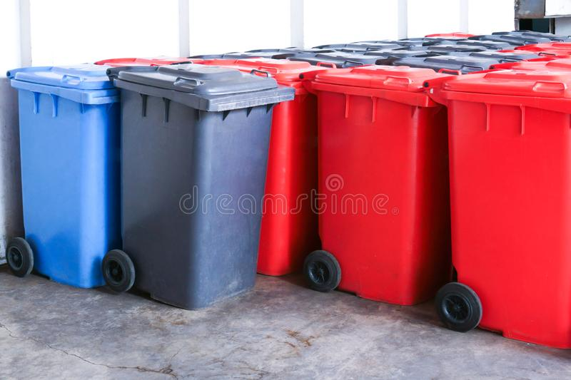 Group of new large colorful wheelie bins for rubbish, recycling waste. Large trash cans garbage bins royalty free stock photo