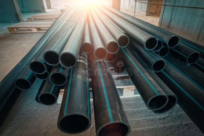 Group of new plastic pipes or tubes on construction site stock photo