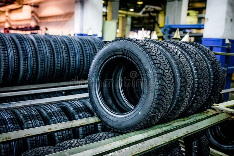 Group of new tires ready for transporting at factory royalty free stock images