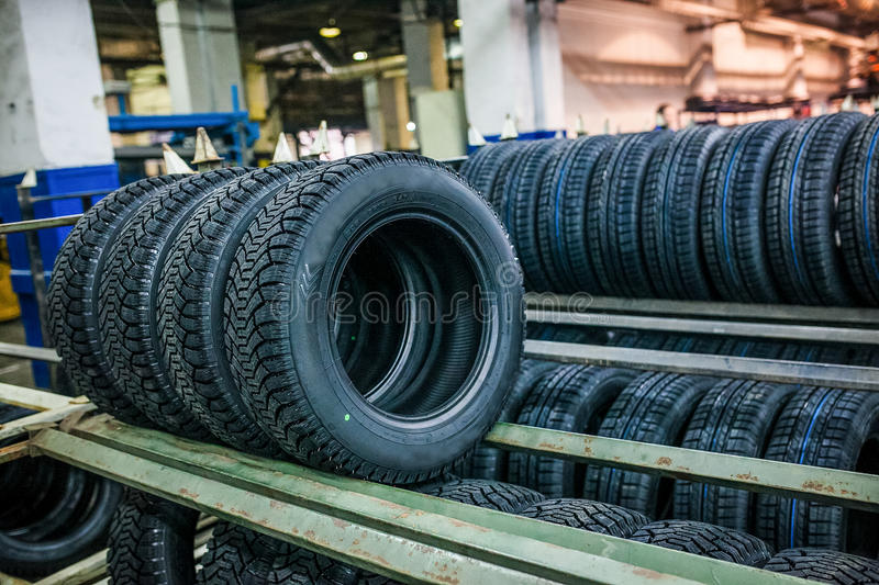 Group of new tires ready for transporting at factory stock images