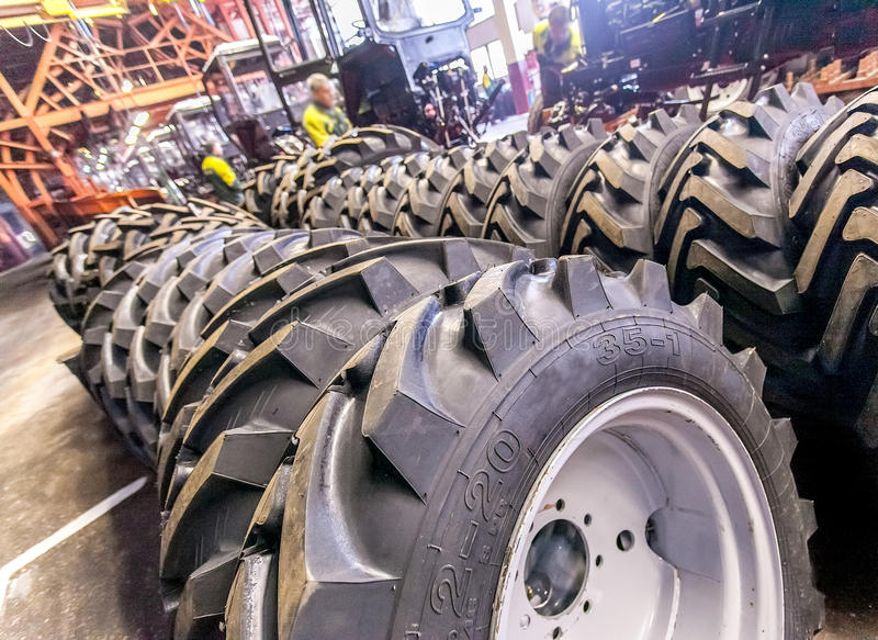 Group of new tires ready for transporting at factory royalty free stock photo