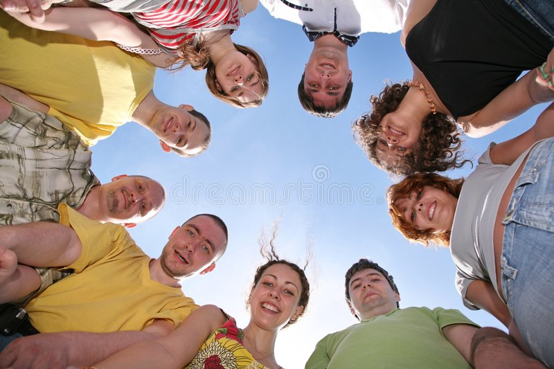 Group of nine friends. Are in a circle stock photo