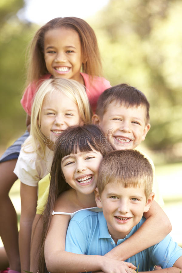 Free Group Of Children Piled Up In Park Stock Photography - 55889842