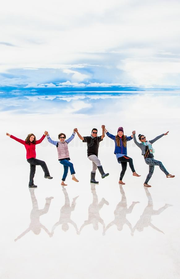 Free Group Of People Make Figures With Their Bodies On The Lake Salar De Uyuni, Bolivia. America Royalty Free Stock Image - 150762946