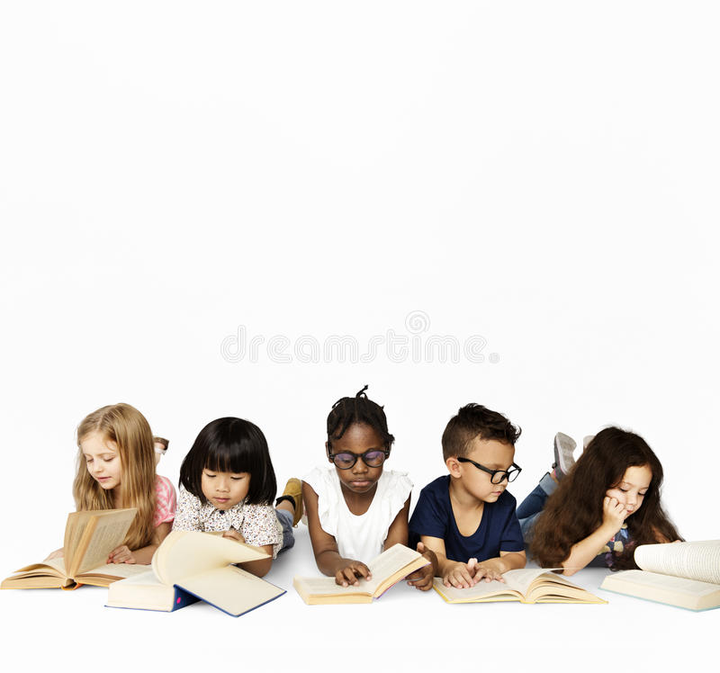 Free Group Of School Kids Reading For Education Stock Photo - 96005750