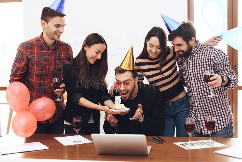 A group of office employees celebrate the fifth anniversary of their company. stock photos