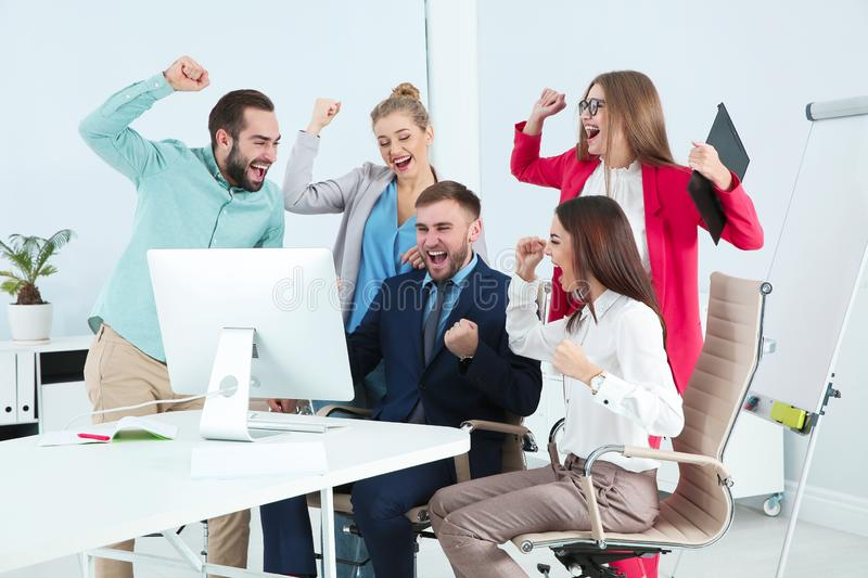 Group of office employees celebrating victory royalty free stock photos
