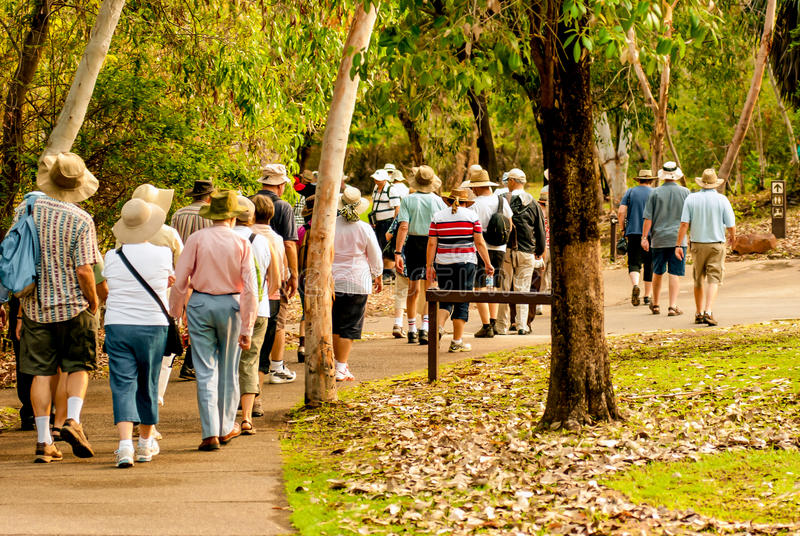 Group of old and healthy people walking in the nature. Australia stock image