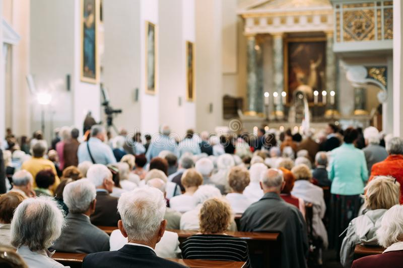 Group Of Old People Parishioners in Cathedral Church.  royalty free stock image
