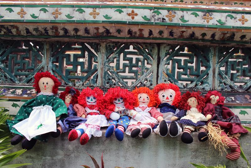 Group Old Time Rag Dolls sitting outside, Ghost mystic dolls. Scary horror dolls. Group Old Time Rag Dolls sitting outside, Ghost mystic dolls. Scary horror stock photography