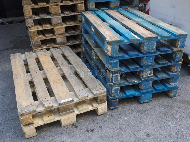 Group of old wooden pallet stacked outside wharehouse. Ready for the transport of goods stock photography