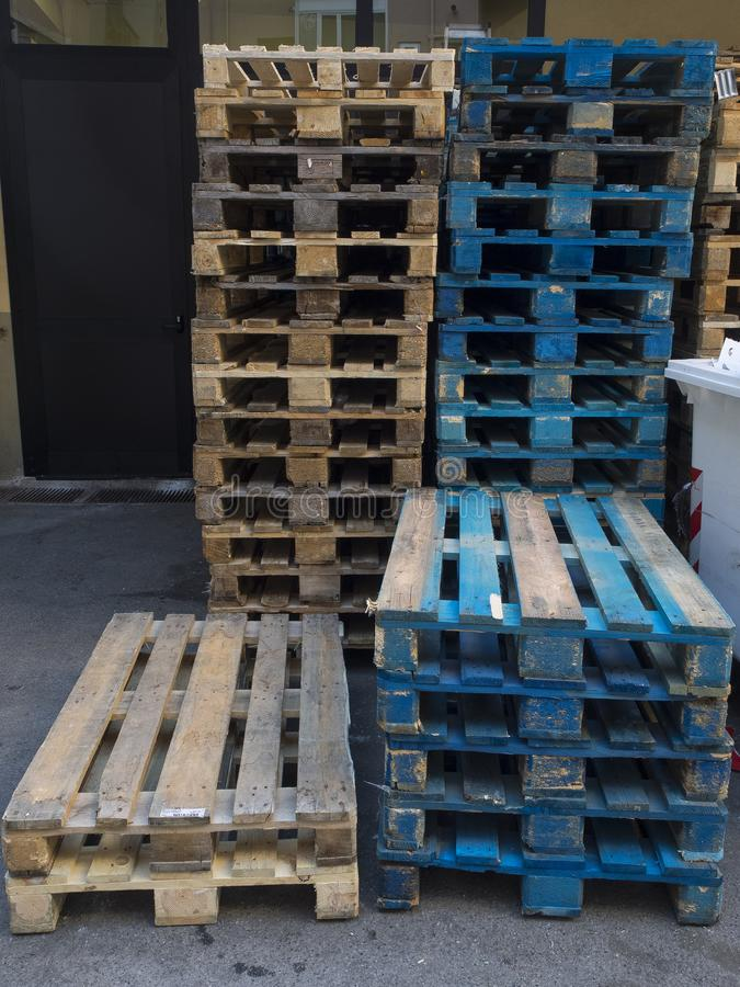 Group of old wooden pallet stacked outside wharehouse. Ready for the transport of goods royalty free stock photos
