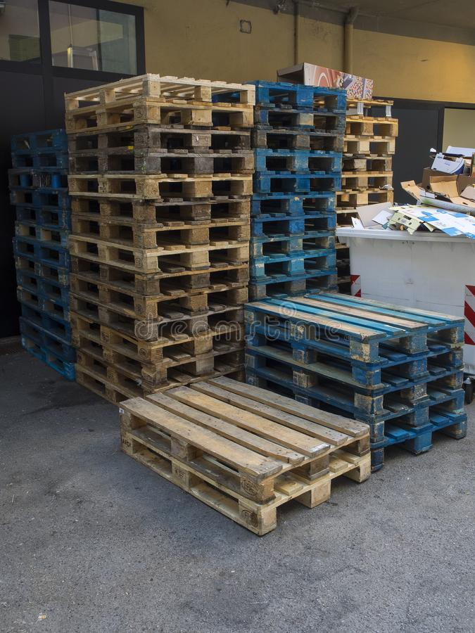 Group of old wooden pallet stacked outside wharehouse. Ready for the transport of goods stock photos