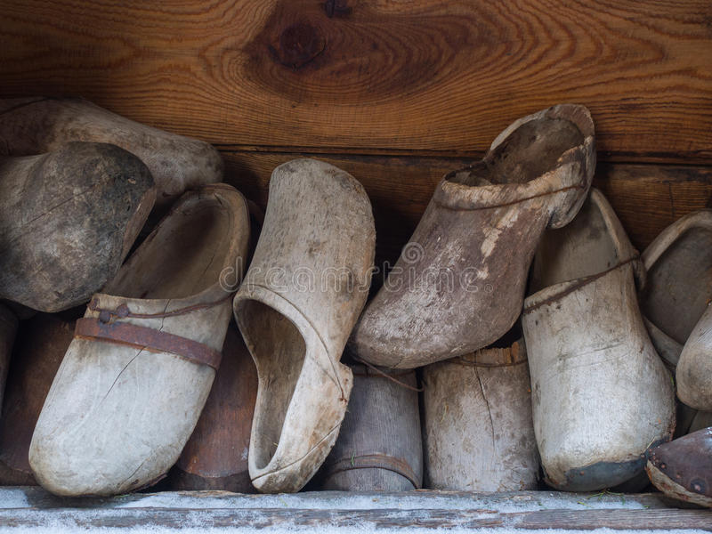 Group of old wooden shoes, vintage hand made in mountains stock photo