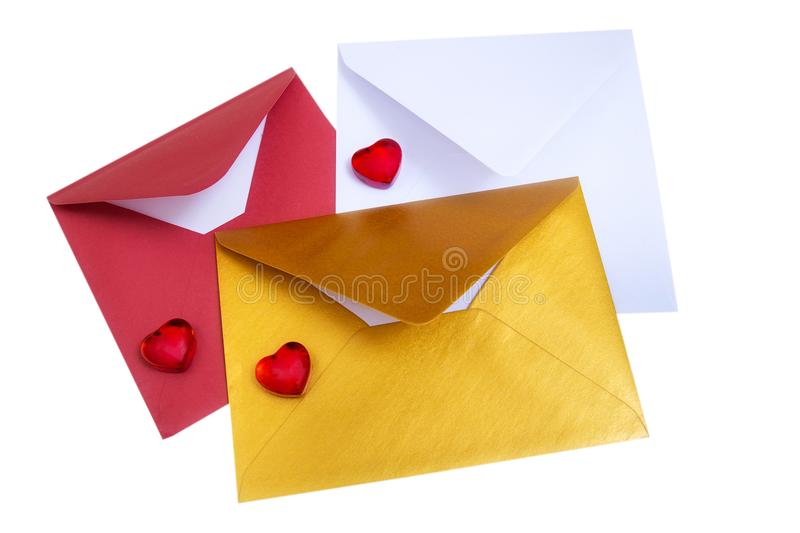 Group of open multicolored envelopes with red hearts. stock photo