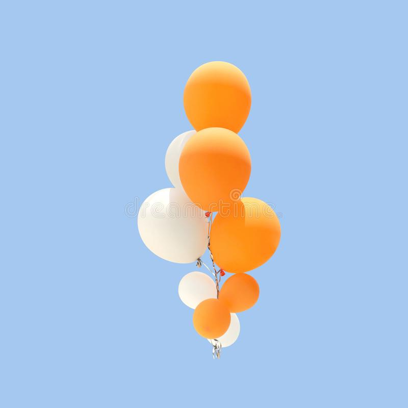 Group of orange and white color balloons stock photography
