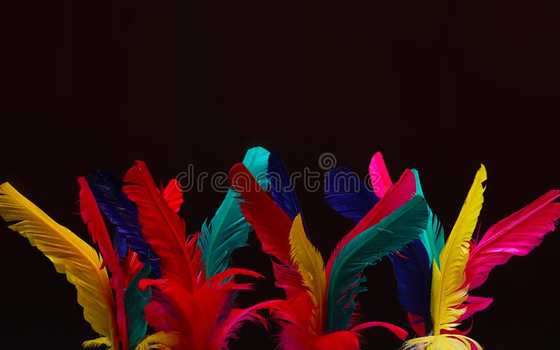 Colorful feather Shuttlecock in red, pink, yellow stock photos