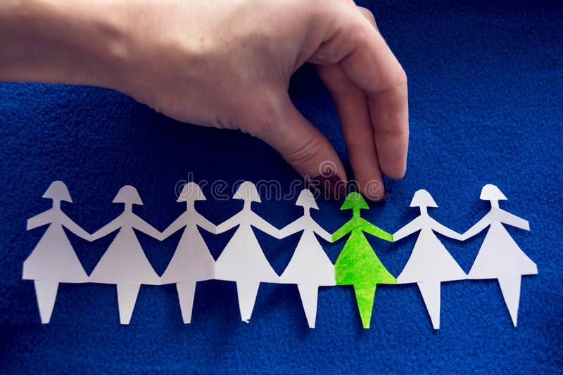 Group of paper women as a concept of togetherness, society etc royalty free stock photography