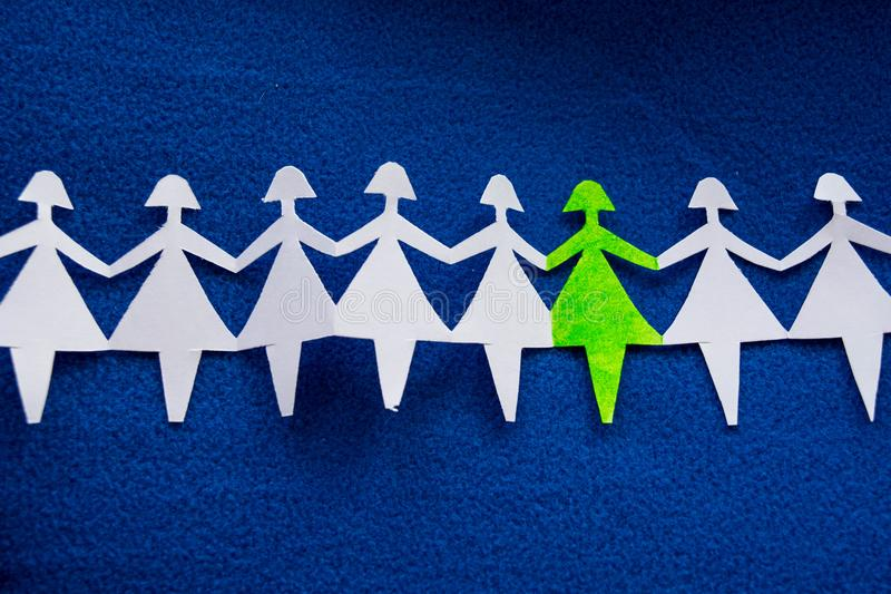 Group of paper women as a concept of togetherness, society etc. royalty free stock photos