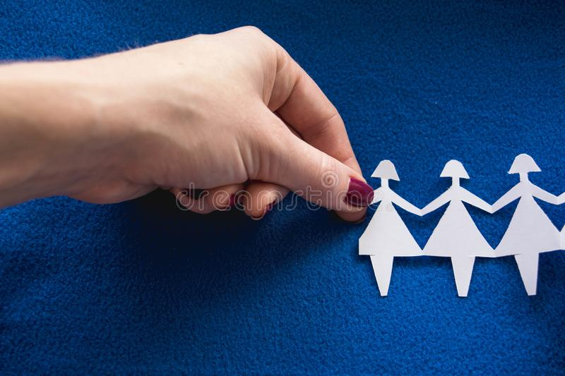 Group of paper women as a concept of togetherness, society etc. stock image
