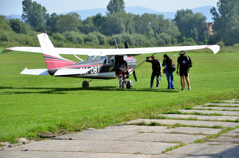 Group of parachutists stand on the ground ready to board a plane stock images